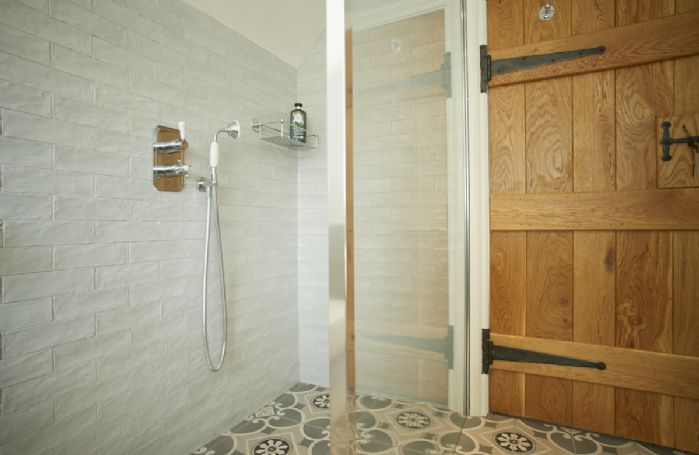First floor: Family bathroom freestanding cast iron bath and separate walk in wet room shower