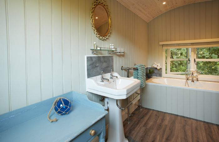 The bathing and dressing hut with double ended bath and walk in shower