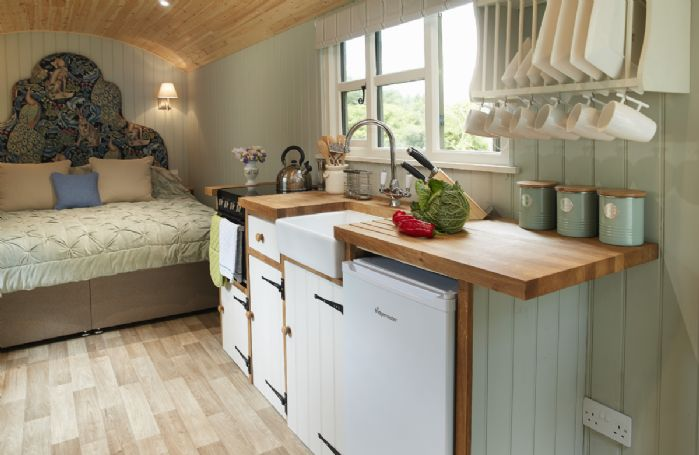 The main shepherd's hut with super king bed, well appointed kitchen and dining area