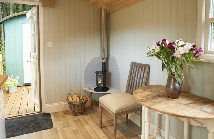 The main shepherd's hut with compact yet effective wood burning stove