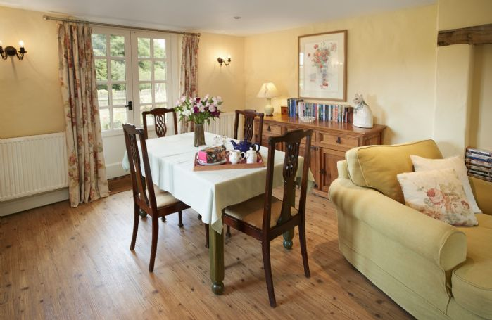 Ground floor: Open plan kitchen, sitting and dining areas with french doors onto the patio