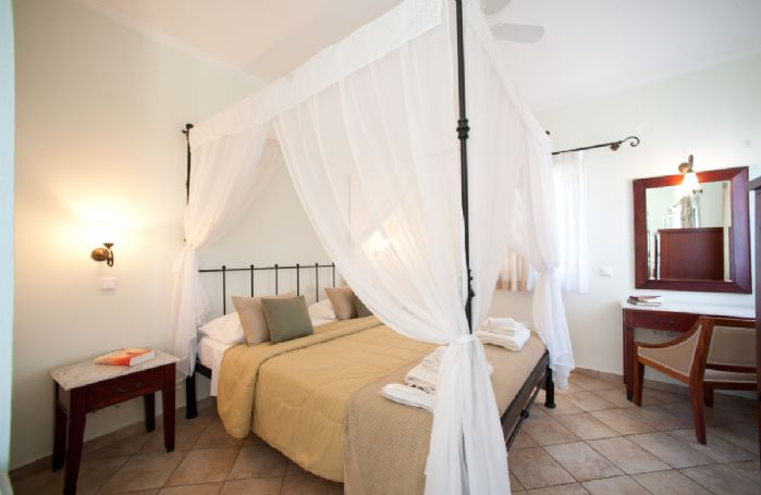 Second floor: Master bedroom with four poster bed, dressing room, balcony and en-suite bathroom