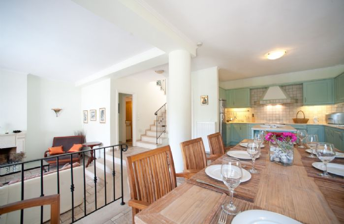 Ground floor: Open plan kitchen/dining area and sunken sitting room with open fireplace and French windows to terrace