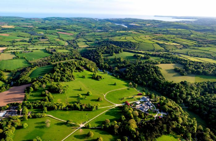 Aerial view of Boconnoc House and surrounding countryside
