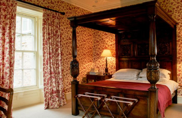 First floor: Victorian bedroom with double 5' four poster bed