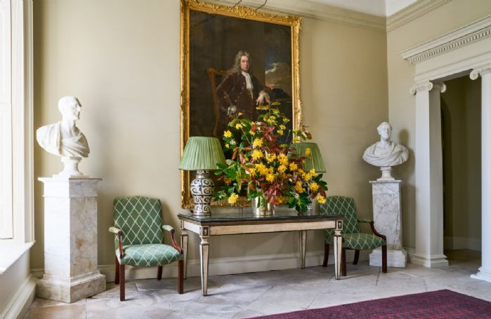 The impressive entrance hall with elegant paintings and statues