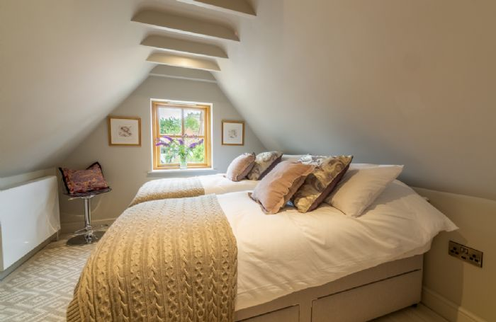 First floor: Light and spacious bedroom with king size zip and link beds