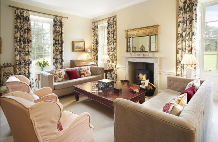 Ground floor: Drawing room with wood burning stove and garden views