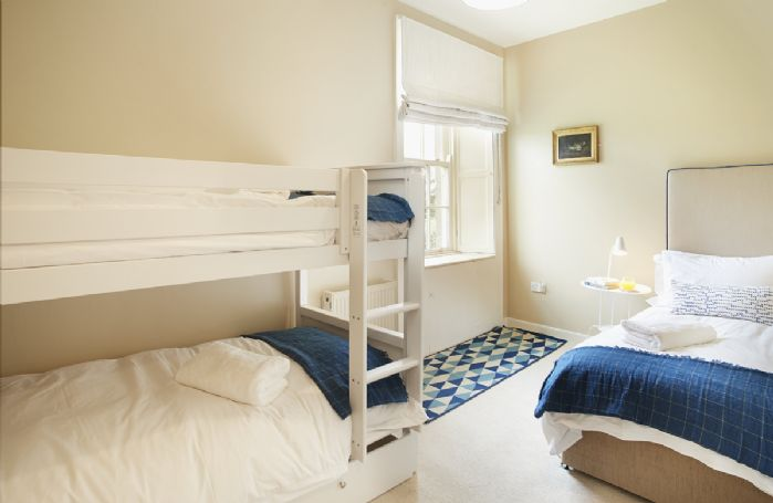 First floor: Bedroom five with 3' bunk beds and 3' single bed