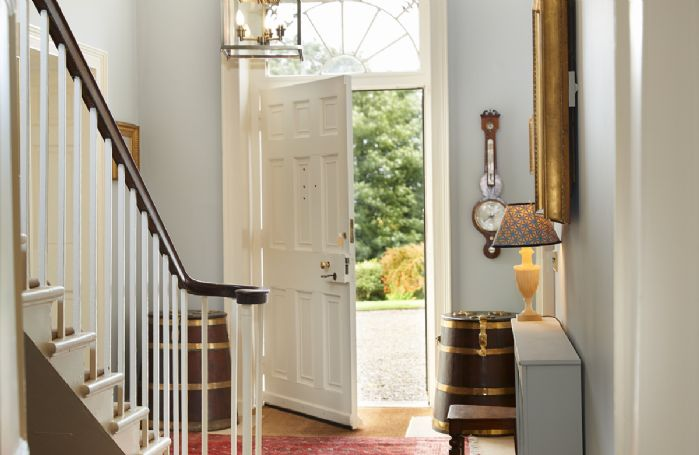 Ground floor: Spacious entrance hall with central staircase leading to first floor bedrooms and bathrooms