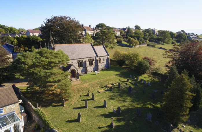 Aerial view of St Anne's Church, Over Haddon, a grade II listed parish church