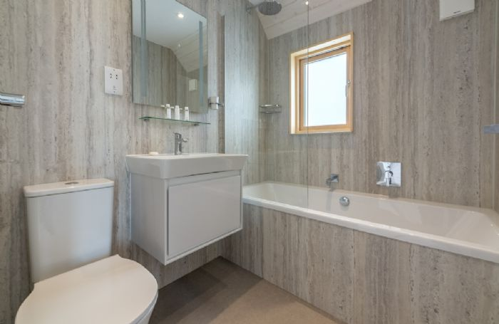 Spacious and contemporary en suite with bath and overhead shower