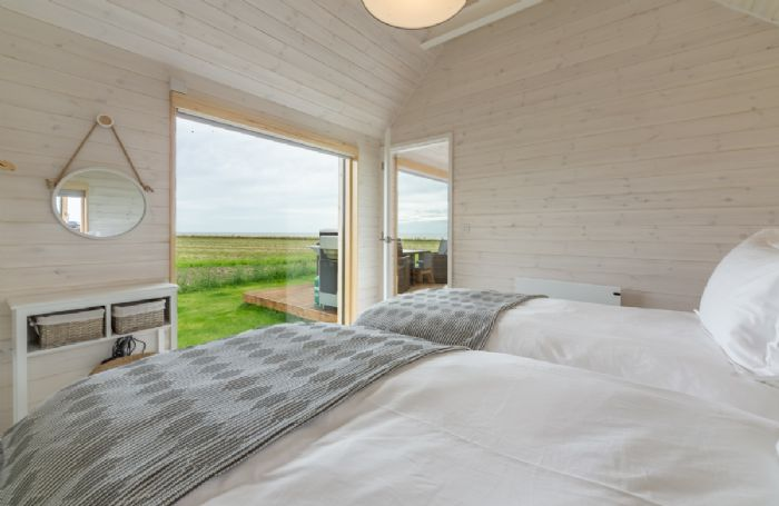 Super king zip and link beds, sea views and en suite with shower.