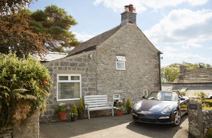 Winsmore Cottage has parking for two cars in the drive