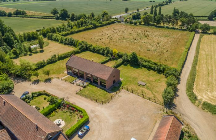 Owl Barn, situated within a contemporary development of farm buildings on an eight acre site with a secure gated entrance