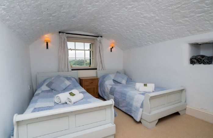 First floor:  Twin bedroom with 3' single zip and link beds which can be converted 6' king sized bed on request