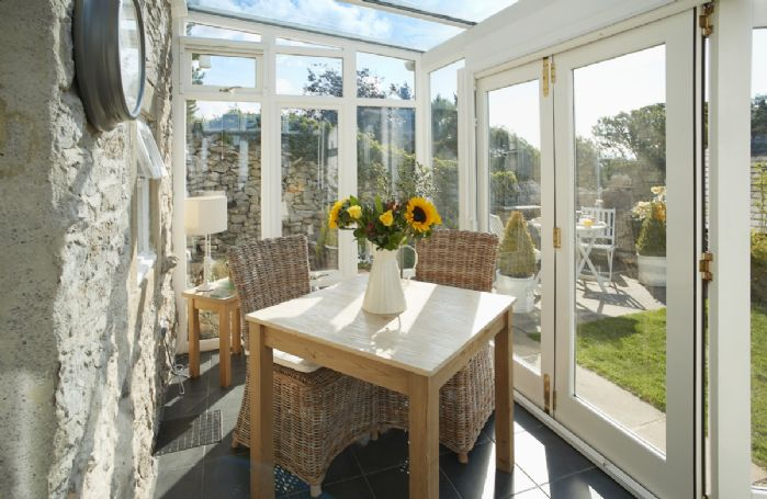 Ground floor: Seating for two in the modern conservatory