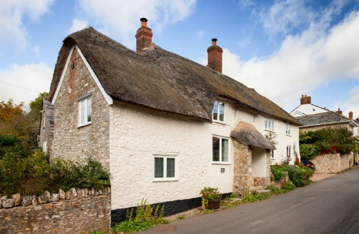Kites Holt is a stunning grade II listed semi detached thatched cottage with private entrance
