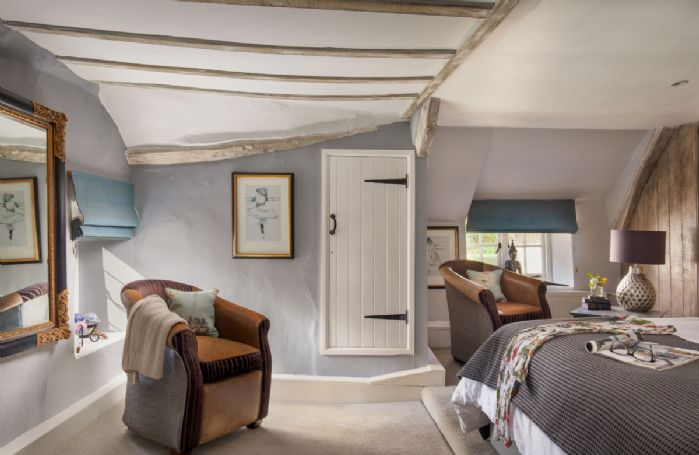 First floor: Triple aspect master bedroom with windows offering views across the countryside