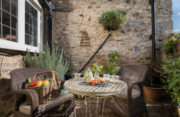 Seating and table for two with views of the village church and countryside