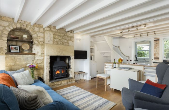 Ground floor: The open plan sitting room with dining area and kitchen
