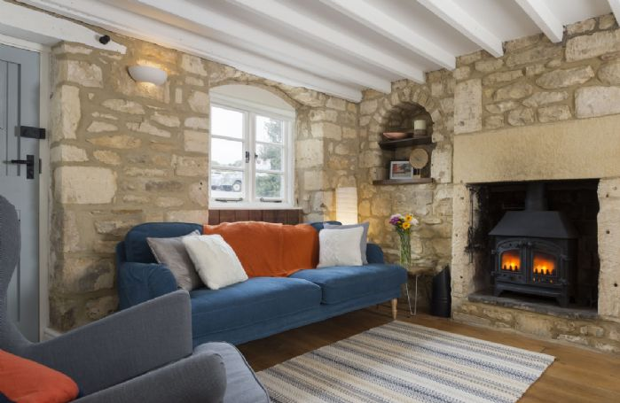 Ground floor: The cosy living room with its beamed ceilings and original wooden floor boards