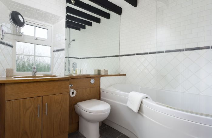 Fist floor: The bright bathroom with bath and shower above