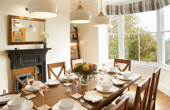 Ground floor: Dining room seating eight guests enjoys a wood burning stove
