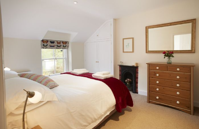 Second floor: Double bedroom with king size zip and link bed