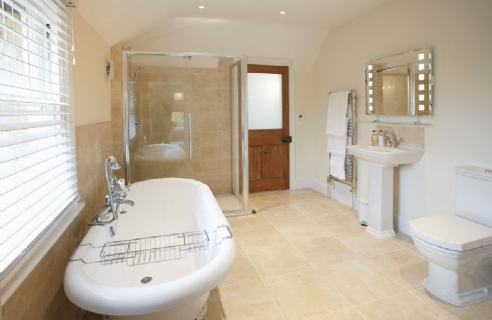 Second floor: En suite master bathroom with free standing roll top bath, walk in shower and underfloor heating