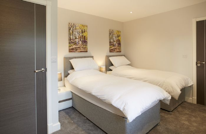 Ground floor: Double bedroom with twin zip and link beds (converting to a superking if required)