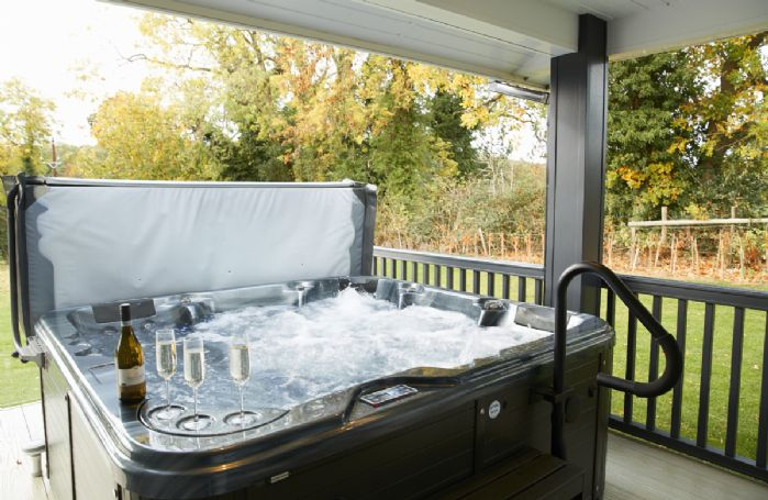 Relax in the hot tub on the veranda