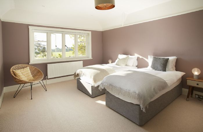 First floor: Large bedroom with 6' king size zip and link double bed