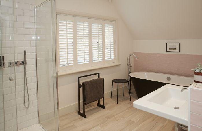 First floor: En-suite bathroom with shower and freestanding bath