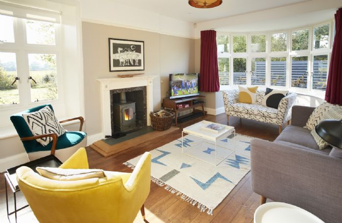 Ground floor: Comfortable living room with television and DVD player