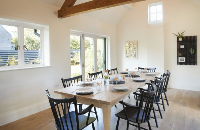 Ground floor: Dining room for up to twelve guests, with bi fold doors opening out onto the garden