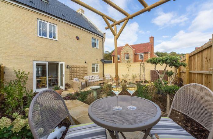 Courtyard garden with pergola and garden furniture