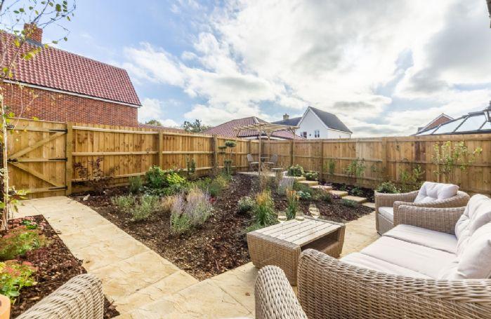 Rattan garden furniture in the enclosed courtyard garden
