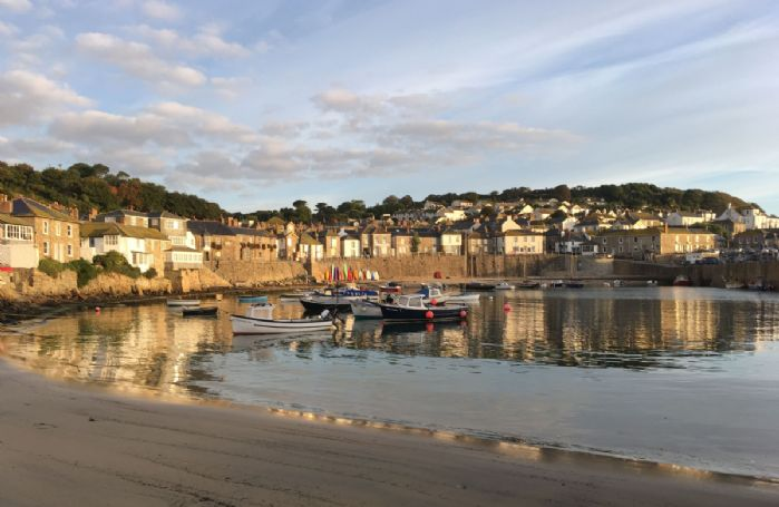 Enjoy a stroll along the beach in tranquil Mousehole