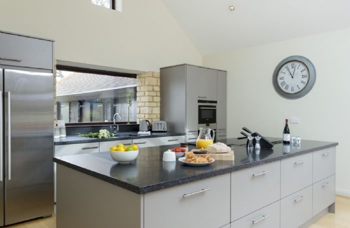 Ground floor: Open plan modern and fully equipped kitchen