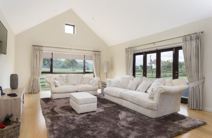 Ground floor: Panoramic views across the countryside from this spacious sitting room