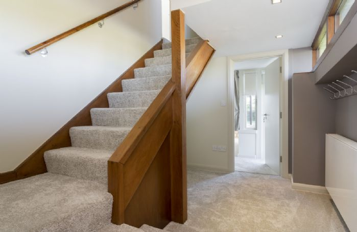 Ground floor: Spacious hallway with stairway leading to the first floor bedrooms