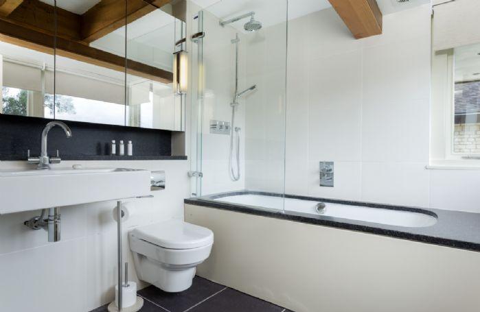 First floor: Modern family bathroom with shower over bath