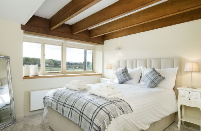 Ground floor: Double bedroom with king size bed and shower wet room next door