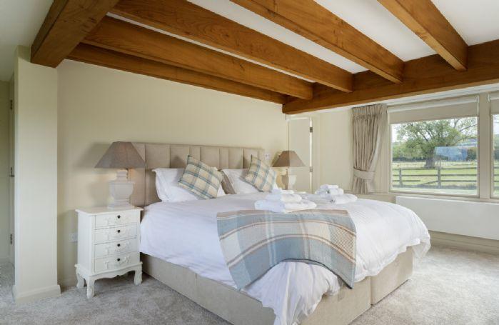 Ground floor: Master bedroom with super king bed and en suite bathroom