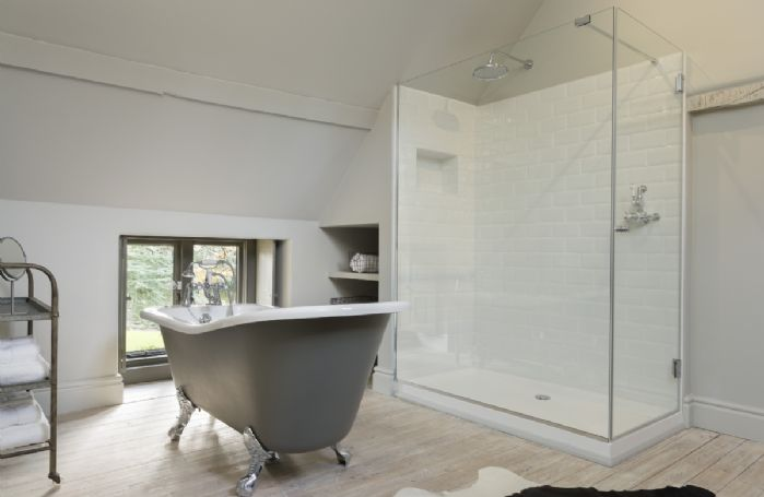 First floor: En-suite bathroom with roll-top bath and walk in shower