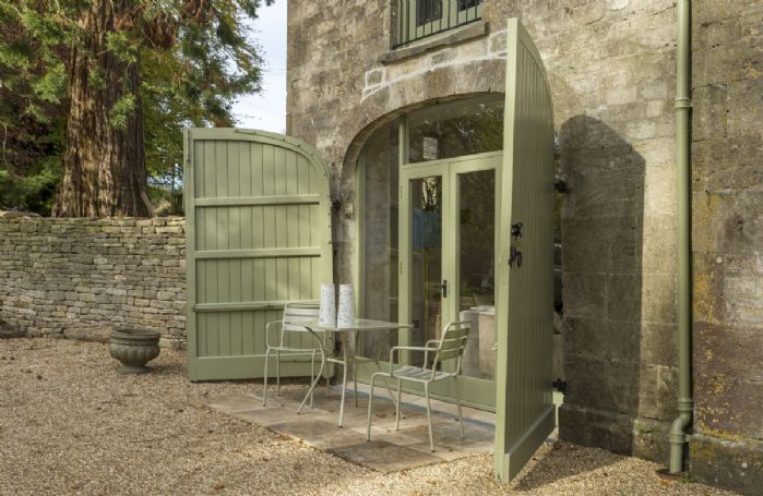 The Coach House has it's own small patio area in front of the French doors leading to the sitting room