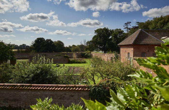 The cottage garden backs onto the original eight acre walled garden