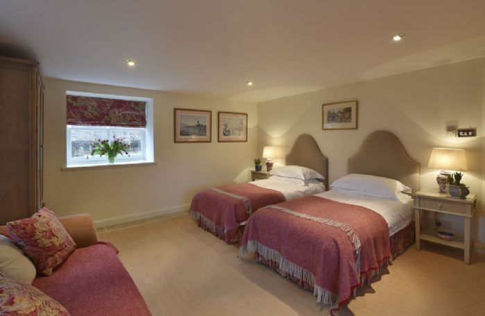Ground floor: Twin bedroom with zip and link beds (can be configured as super king bed on request)