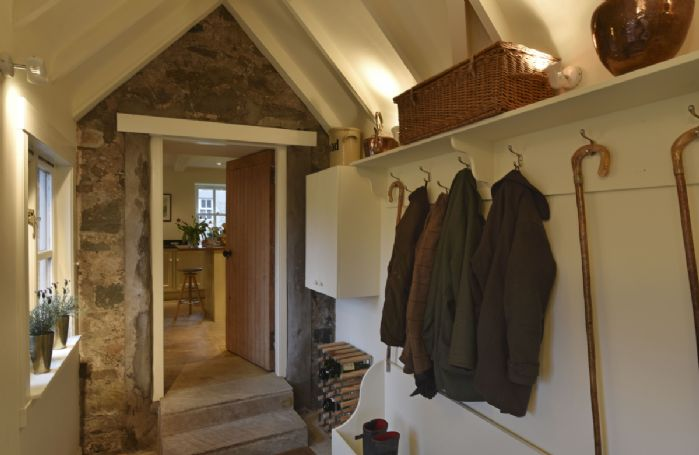 Ground floor: Porch with coat hooks and storage for boots and outdoor clothes